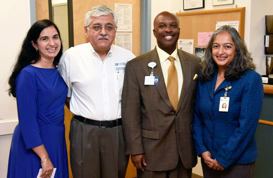 From left, Reetu Grewal, M.D.; Mobeen Rathore, M.D.; Leon L. Haley Jr., M.D., MHSA; and Nipa Shah, M.D., pose for a photo while marking the receipt of an award to implement and study telemedicine-based HIV care.